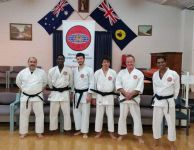 New Maylands Black Belts Edward, Mihael & Rezah standing with Senseis Osmar, Howard & Mark